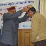 Monu receiving his award from Prof P K Dhumal, CM Himachal Pradesh